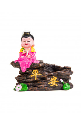 GUAN YIN SITTING ON THE ROCK